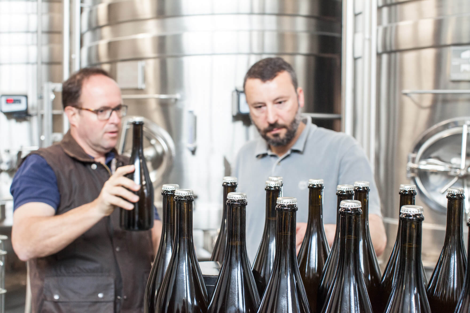 Mark and Jonathan Bottling vintage wine