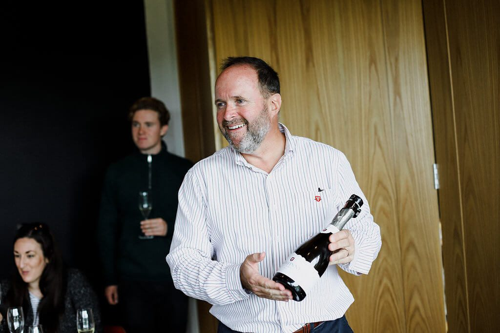 Mark Driver Holding a Bottle of Rathfinny Wine