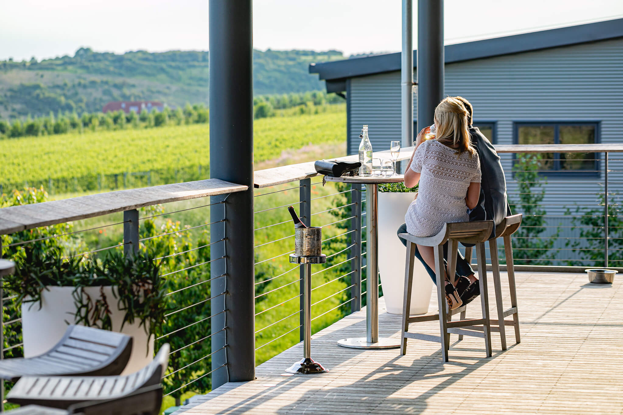 Couple sitting on the balcony overlooking the Vineyard