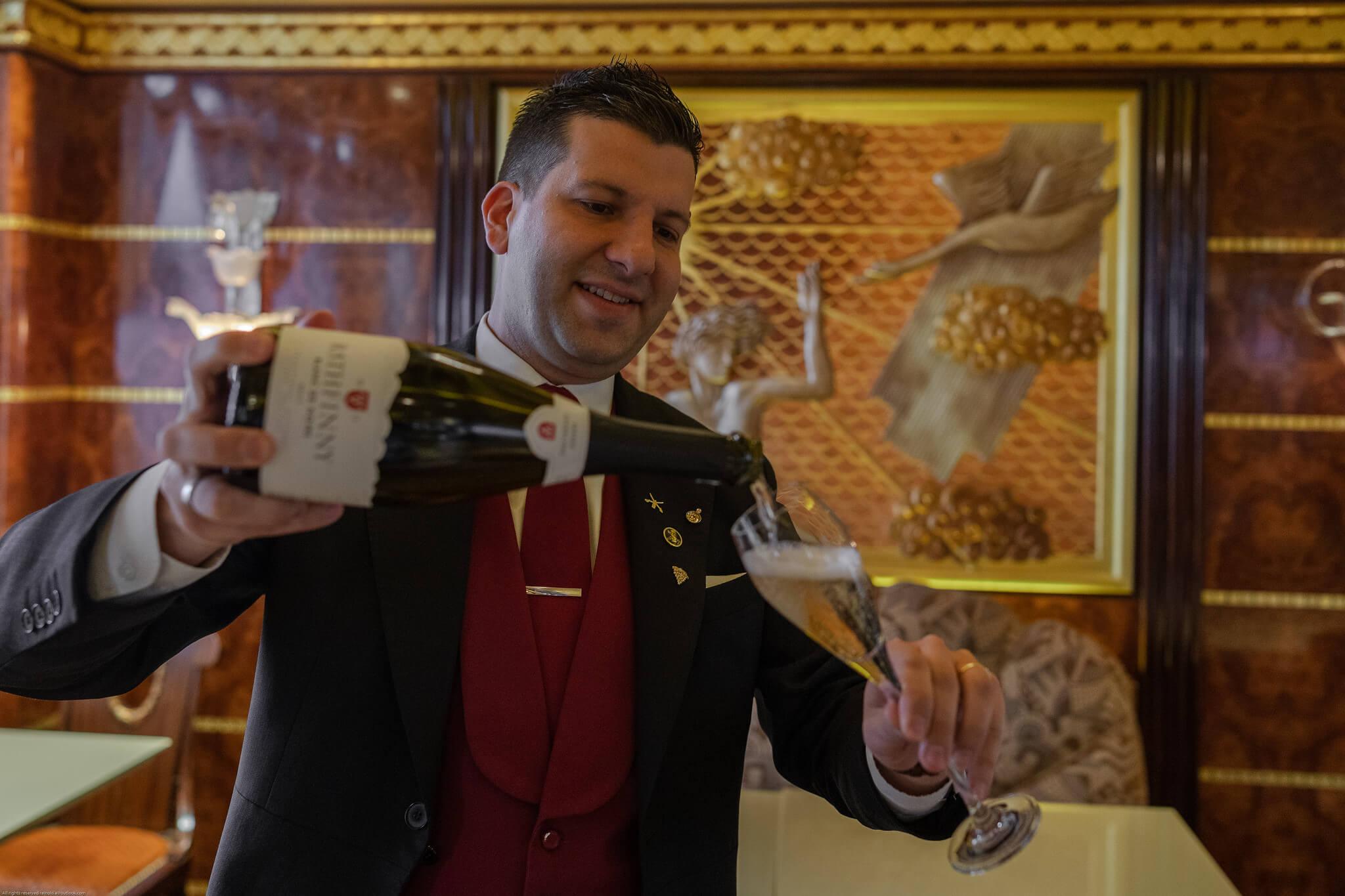 Ritz Sommelier Pouring Rathfinny